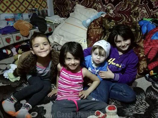 Cei patru copii ai familiei rămasă fără locuinţă în mijlocul iernii